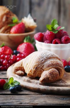 Fresh croissant with mix of berry - stock photo
