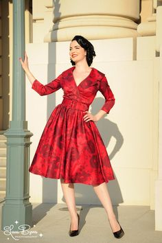 Birdie Dress in Red Rose Meredith Satin with Three Quarter Sleeves - The Birdie Dress is a full skirted, vintage-style party dress with a wide, notched collar creating a classic, polished silhouette. Finished off with a side zipper and wide matching belt.  In Pinup Couture's festive red on red floral print, this dress is a real head-turner!