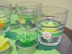 To make these Easter table decorations/party favors you will need glass votive holders, ribbon, 3D floral stickers, floral tea lights and pastel ribbon. http://www.dollarstorestyle.com/entertainingEaster.html