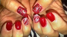Fourth of July nail design!  Acrylic nails with free hand nail art on ring fingers and thumbs and gel top coat.