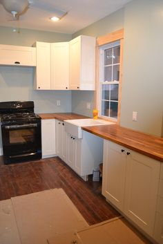 Framhouse sink, white cabinets, wood countertops