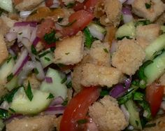 A fabulous bread salad with tomatoes, cucumbers, basil, onions: http://www.tastygalaxy.com/cook/panzanella-salad-recipe/