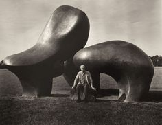 Sculptor Henry Moore sitting before his Sheep Piece (1971-72) in Hoglands, Hertsfordshire, England.