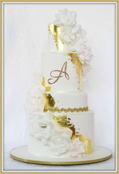 Gold leaf and rice paper flower wedding cake