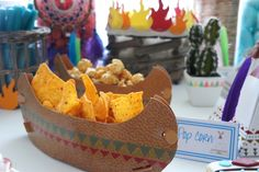 Snacks placed in paper canoes from a Pow Wow Birthday Party on Kara's Party Ideas   KarasPartyIdeas.com (17)