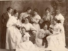 Goofy picture of friends. I love it. The best is the girl about to pour water on her friend's head. My best guess, 1897.