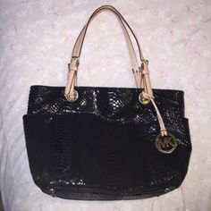 Michael Kors Handbag Black snakeskin with metallic gold interior - zipper closure on top and pockets inside and on sides of bag - great condition Michael Kors Bags