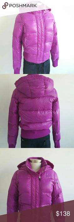 NIKE Puffed Down 700 Winter Hooded  Jacket Nike Puffed 700 Hooded  jacket, perfect for winter and very warm , purple color,  very lightweight,  going well with leggings boots. Excellent condition been worn only one time. Zip closure, zip pockets on the front, interior zip pocket for cell phone. Nike Jackets & Coats Puffers