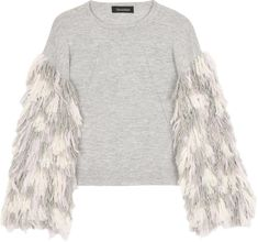 57f50b04bc5b91 It is all about the statement sleeve with the Berber fringe sweater. Hand  fringed with