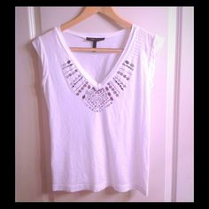 Embellished BCBG Southwestern V Neck Tee Embellished BCBGMAXAZARIA tee. Has some loose strings here and there but in good condition. No stains or tears. The accents catch the light and adds a little bling if you want to dress down or add a blazer to dress up. Soft material and very comfy. BCBGMaxAzria Tops