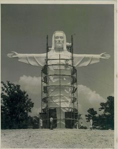 The seven-story Christ of the Ozarks Statue continues to be one of the most visited attractions in the Ozarks. Standing sixty-seven feet high, the statue overlooks the picturesque Victorian village. Victorian Village, Eureka Springs, Scaffolding, Most Visited, Vintage Photographs, Arkansas, Statue Of Liberty, Christ, Places To Visit
