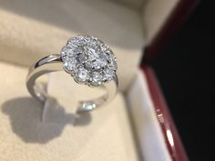 Featuring a stunning round brilliant cut diamond surrounded by 10 smaller diamonds. Made by hand in our Melbourne studio.