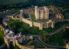 """Dover Castle, Dover, Kent, England... www.castlesandmanorhouses.com ... Dover Castle was founded in the 12th century and has been described as the """"Key to England"""" due to its defensive significance. It is the largest castle in England. During the reign of Henry II t the castle began to take recognisable shape. The inner and outer baileys and the great keep belong to this time. Maurice the Engineer was responsible for building the keep, one of the last rectangular keeps ever built."""