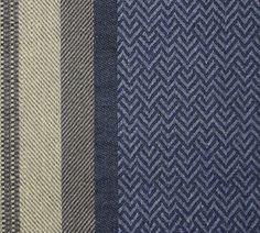 Valdivia Striped Upholstery Fabric A wide dark indigo blue wide chevron stripe, with contrasting herringbone stripes of steel grey and beige.
