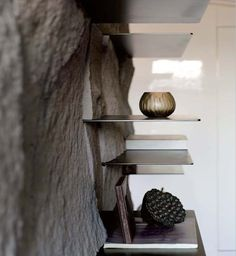 Stunning shelves built in what looks like natural, rough stone. 近境制作 2013 iF 傳達設計獎 唐忠漢設計師