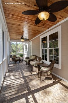 A wooden ceiling lends a rustic feel to this screened porch! http://www.dongardner.com/plan_details.aspx?pid=4411. #Rustic #Screened #Porch