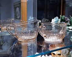 ITEM #RA-111 (Box R-)  Pink depression glass sugar bowl and creamer set in the Old Colony aka Lace Edge pattern by Hocking Glass Co circa 1935-38.  Sugar bowl measures 6 handle to handle and is 2 3/4 tall. Creamer measures 5 1/2 handle to spout and is 3 tall.  Condition: Very good vintage condition with typical wear due to age and handling. No chips found.  To find more great antique and vintage items, please visit my shop at: https://www.etsy.com/shop/PattysPorc...