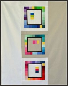 Patchwork Frames quilt in Kona solids, featured at Quilt Story, would be great for the back of a quilt too.  The pattern was created by Beth at Plum & June and is available for free.