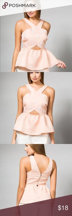 TOP V halter neck line The BLAIR BLUSH PEPLUM TOP features a unique V halter neck line, creating a unique look. With white detailed embroideries. The key hole the by the waist and its peplum finish at the bottom will have you feeling like a total MUSE. Tops Blouses