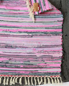 I can't wait for the tasseled re:loom rugs to hit the website... so cute :) Here is a detail I shot. reloom.org