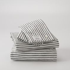 Painterly Stripe Sheet Set - A playful update to a bedroom staple, this striped bedding will bring a dose of crisp, modern style to any bedroom. Designed by Portland artist Ashley Goldberg, the slate-gray stripes have an endearing hand-drawn quality for a whimsical twist on a classic look. Crafted from 200-thread count percale cotton, the tightly woven fibers provide long-lasting durability with a soft, luxurious feel.