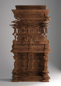 This cabinet only looks like the screen is glitched. It actually is as it appears! Carved by Ferruccio Laviani