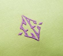 Julia B. A17 Monogram in purple embroidery thread on chartreuse linen