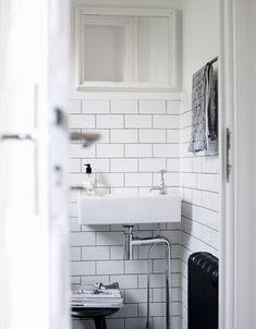 White tiles black grout black heating radiator