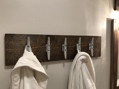 Boat towel hangers - adorbs! https://www.etsy.com/listing/507531604/nautical-coat-rack-with-cleats-rustic