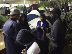 PENN STATE – PATERNO – Sue Paterno, widow of long time Penn State coach Joe Paterno, visits students camped out at Nittanyville the night before the game against Michigan.
