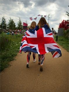 Patriotic fans enjoy the Olympic Park. July 28, 2012. Love this Union Jack photo......Olympics- London, England