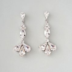 "Crystal Deco Style Bridal Earrings. Dangling crystal earrings in rhodium  silver with genuine Swarovski crystals in a beautiful vase shape.  Earrings are 2 3/16"" in length and 7/8"""" in width."
