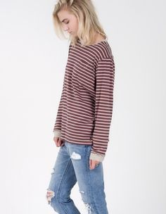 Try this slouchy vintage favorite layered under a graphic tee or short sleeve button up for badass fall style. We love the banded cuffs, contrast crew neck and thin washed jersey material.