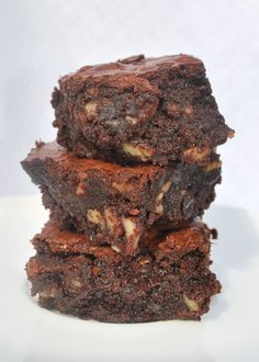 These are incredible little brownies — moist, dense and fudgy in the middle, and chewy on the outside with a wafer thin candy-like crust....