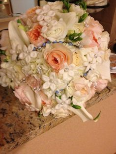 Lovely and light with David Austen roses and stephanotis and a lot of fluff!