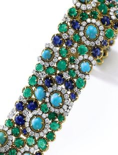 This fabulous turquoise, sapphire, emerald and diamond bracelet by VanCleefArpels.  Sotheby's.