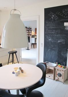 Kitchen-area play zone.  We've already started putting a little area together, and this chalkboard idea is perfect for one of the walls.