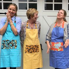 Reversible organic cotton aprons in several colorful options. By Amuse Me Shop http://AmuseMeShop.etsy.com