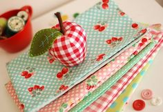 Beautiful fabrics. And I love the gingham apple pincushion!