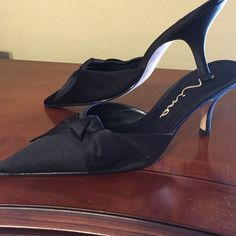 """Black satin mules Barely worn. Beautiful pointed toe Black satin miles with bow. Leather sole. 3"""" heel. Nina Shoes Mules & Clogs"""