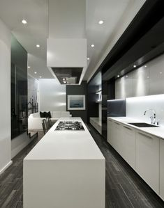 Custom kitchen with an extra long kitchen island by Cecconi Simone _