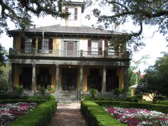 small plantation house -paint it white and you have my ideal house