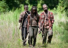 Michonne traveling with her new zombie slaves in Season 4