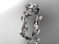 14kt white gold diamond leaf and vine wedding by anjaysdesigns, $975.00 Looks really cool, but as far as comfort...