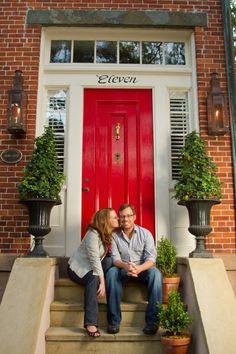 Engagement photo in front of a striking red door in Savannah | http://shannonchristopher.com/2012/05/sara-joshua-savannah-wedding-photographer/