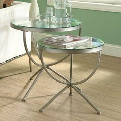 "2 Piece Nesting Tables by Monarch Specialties Inc.. $115.59. Assembly required. Large Table: 24""L x 24""W x 24""H. Satin silver metal finish. 2 PC set includes 2 nesting tables. Tempered glass tops with metal base. I 3322 Features: -Tempered glass top. Construction: -Metal construction. Color/Finish: -Satin silver finish.. Save 49%!"