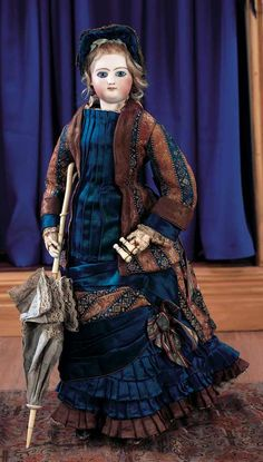 Doll, 46 cm, circa 1870. The doll was commissioned for the exclusive Parisian doll store Aux Enfants Sage. Wearing lovely antique gown,bonnet,opera glasses,parasol,undergarments,stockings,leather boots.