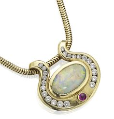 An opal, ruby and diamond pendant.  The pendant set with an oval cabochon-cut opal, with rows of slightly graduated channel-set circular-cut diamonds scrolling to either side with a circular cabochon-cut ruby below, mounted in 18ct gold, suspended from a serpent-link chain, pendant width 27mm, chain length 42cm, chain stamped 750, the opal estimated to weigh approximately 2.13cts, the diamonds estimated to weigh approximately 0.44ct in total