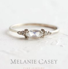 A white gold moonstone ring featuring a marquise cut center accented by clusters of white diamond on a delicate band Find the Moonstone Eyelet Ring at Alternative Engagement Rings, Vintage Engagement Rings, Vintage Rings, Antique Wedding Rings, Engagement Rings White Gold, Nontraditional Engagement Rings, Pretty Engagement Rings, Silver Wedding Rings, Wedding White