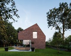 EVA designs a copper roofed contemporary house in a dutch ribbon development